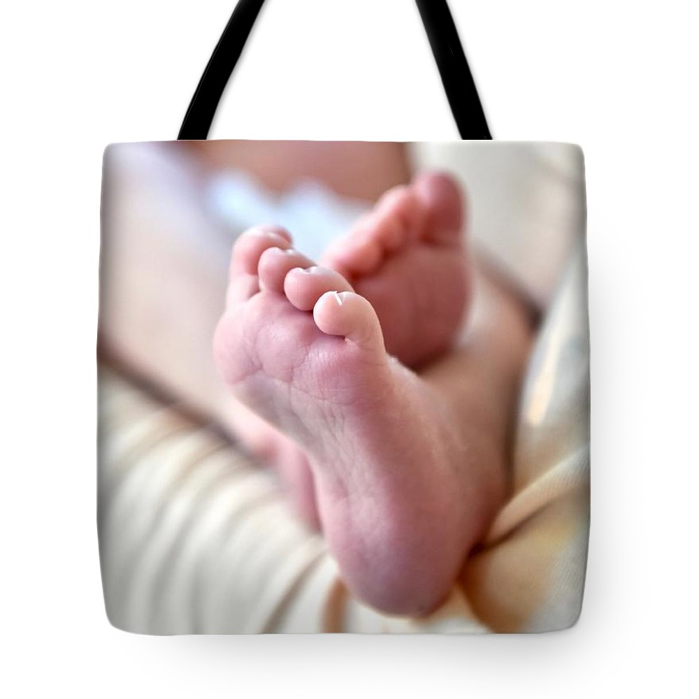 Babies Feet Tote Bag featuring the photograph Babies Feet by Jeramey Lende