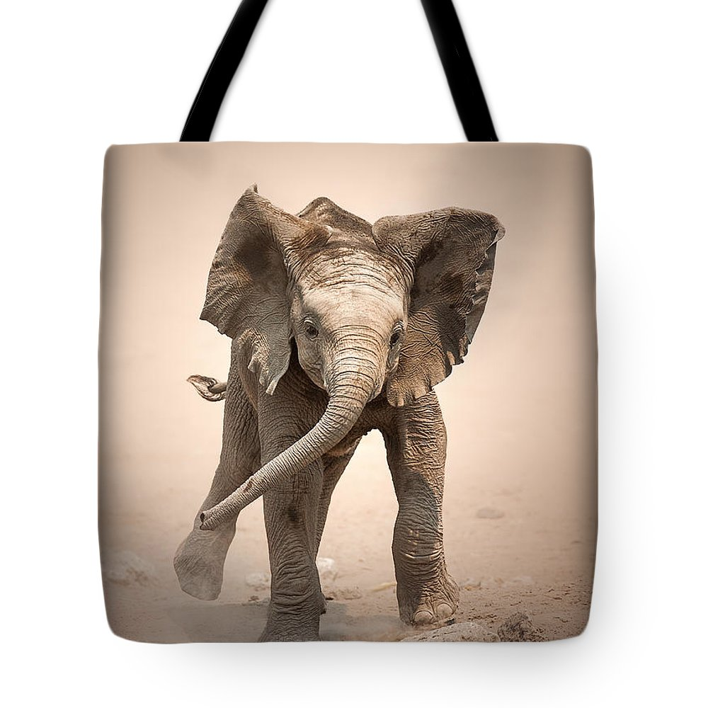 Elephant Tote Bag featuring the photograph Baby Elephant Mock Charging by Johan Swanepoel