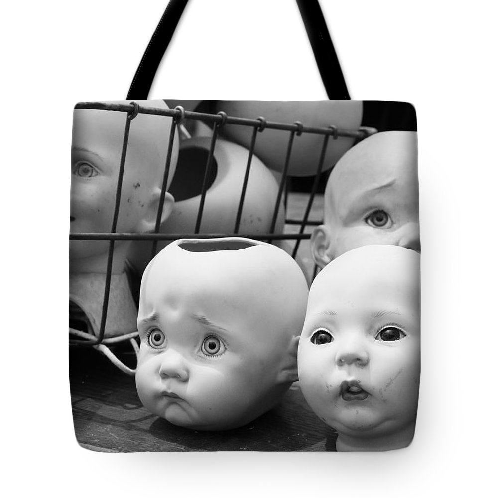 Baby Heads Tote Bag featuring the photograph Baby Heads, No.1 by Andre Brown