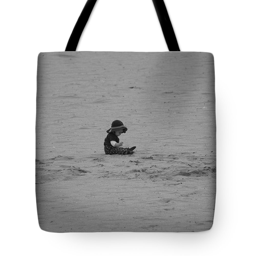 Black And White Tote Bag featuring the photograph Baby In The Sand by Rob Hans