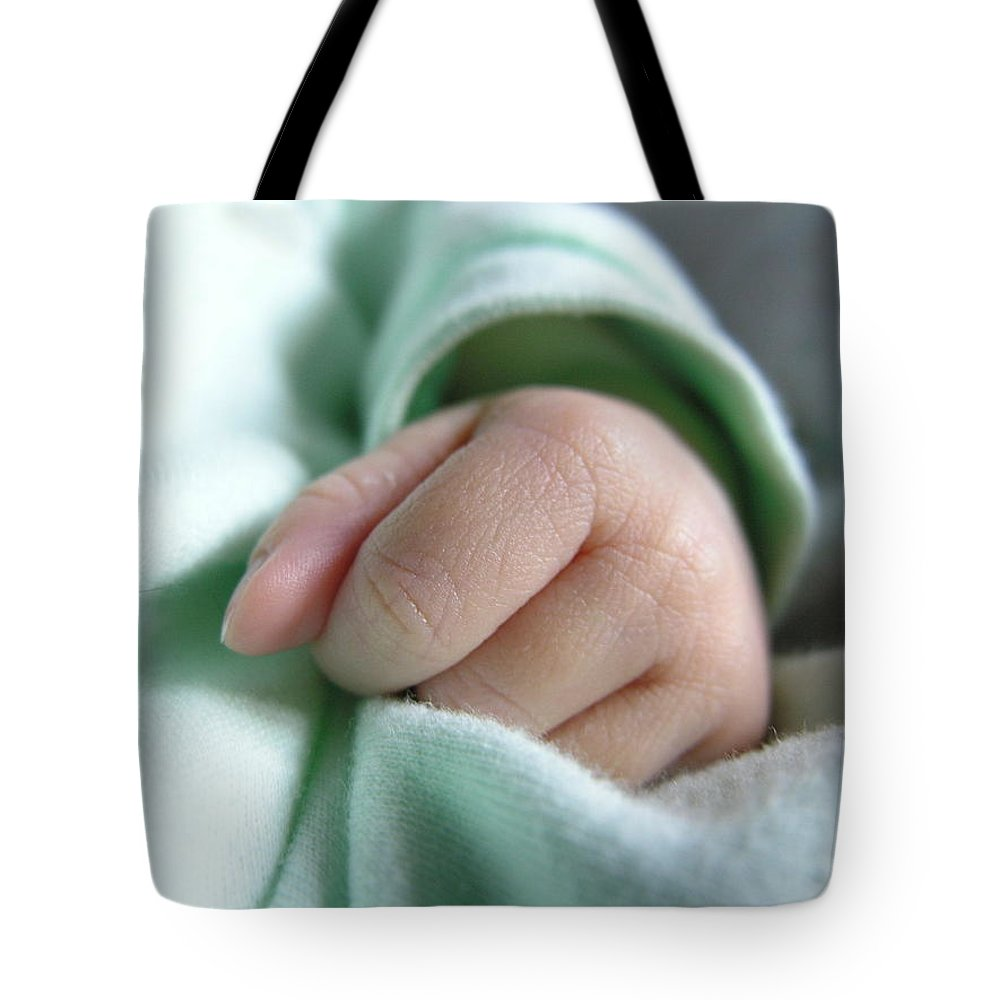 Baby Tote Bag featuring the photograph Baby's Hand by Natasha Sweetapple