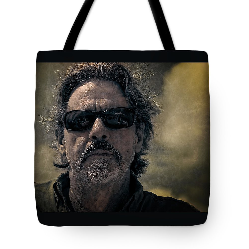 Man Tote Bag featuring the photograph Badass Man In Sunglasses Stares Into The Unknown by Sharon Minish