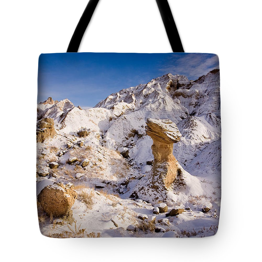 Hoodoo Tote Bag featuring the photograph Badlands Hoodoo In The Snow by Rikk Flohr