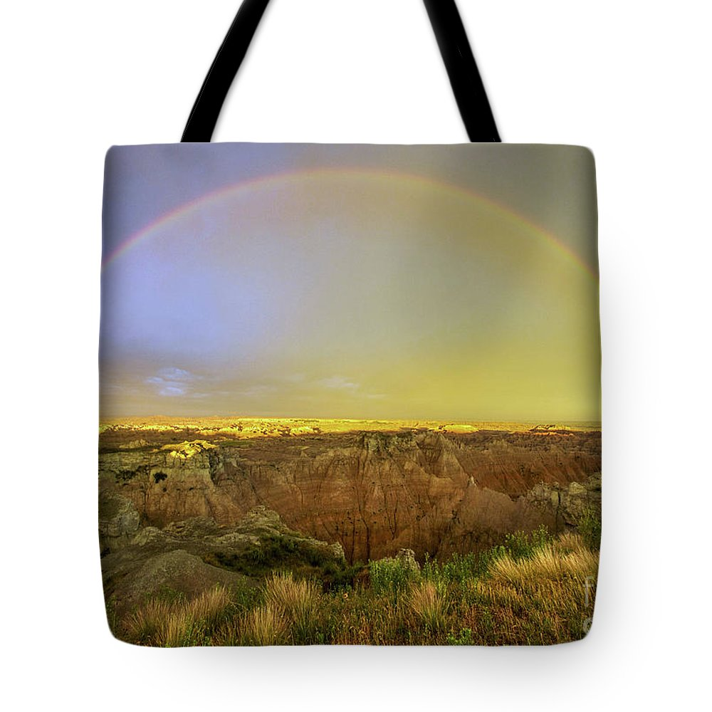 Rainbow Promise Tote Bag featuring the photograph Badlands Rainbow Promise by Karen Jorstad