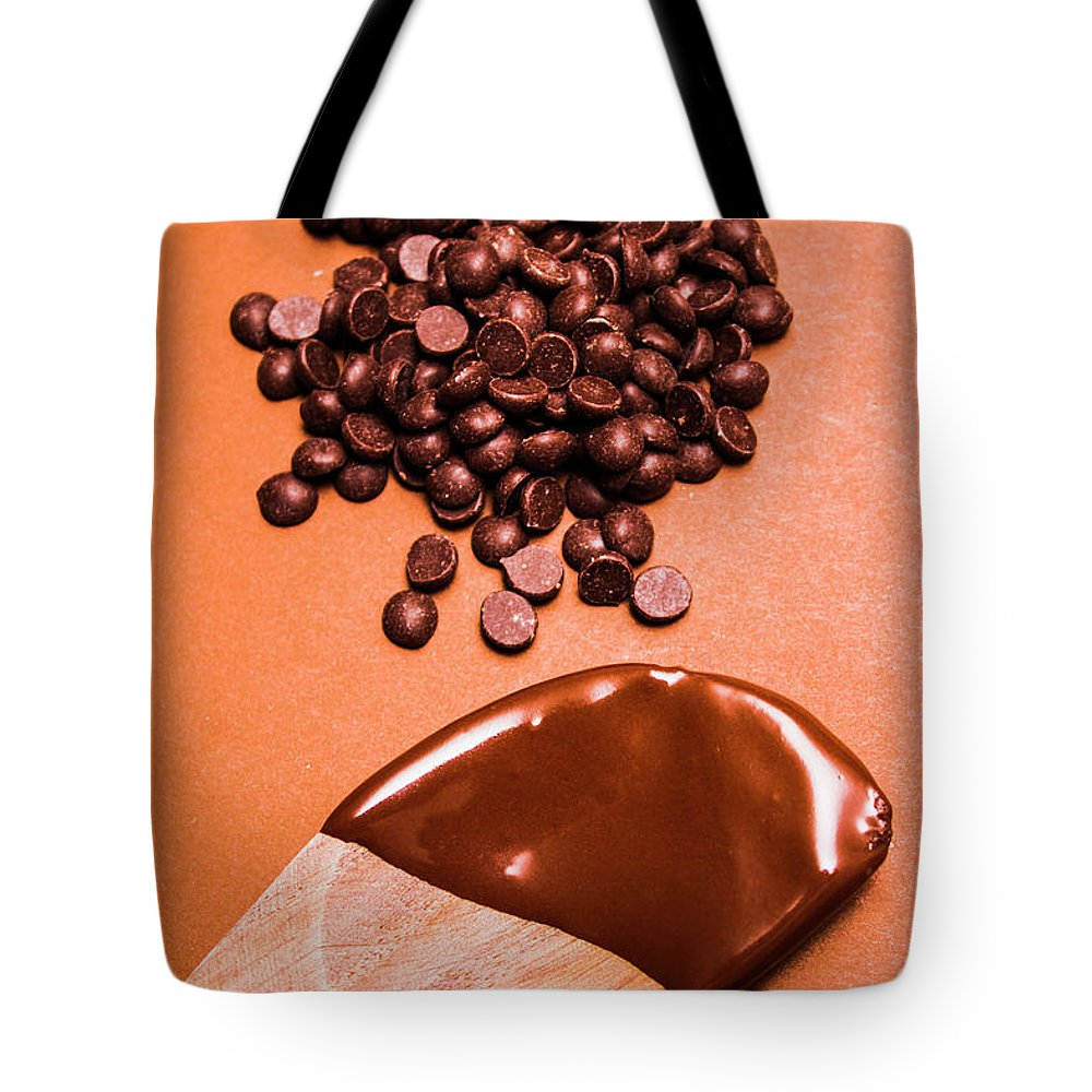 Bakery Tote Bag featuring the photograph Baking Scene Of Spoon Covered With Chocolate by Jorgo Photography - Wall Art Gallery