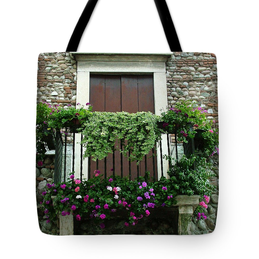 Italy Tote Bag featuring the photograph Balcony On Pebbled Wall by Donna Corless