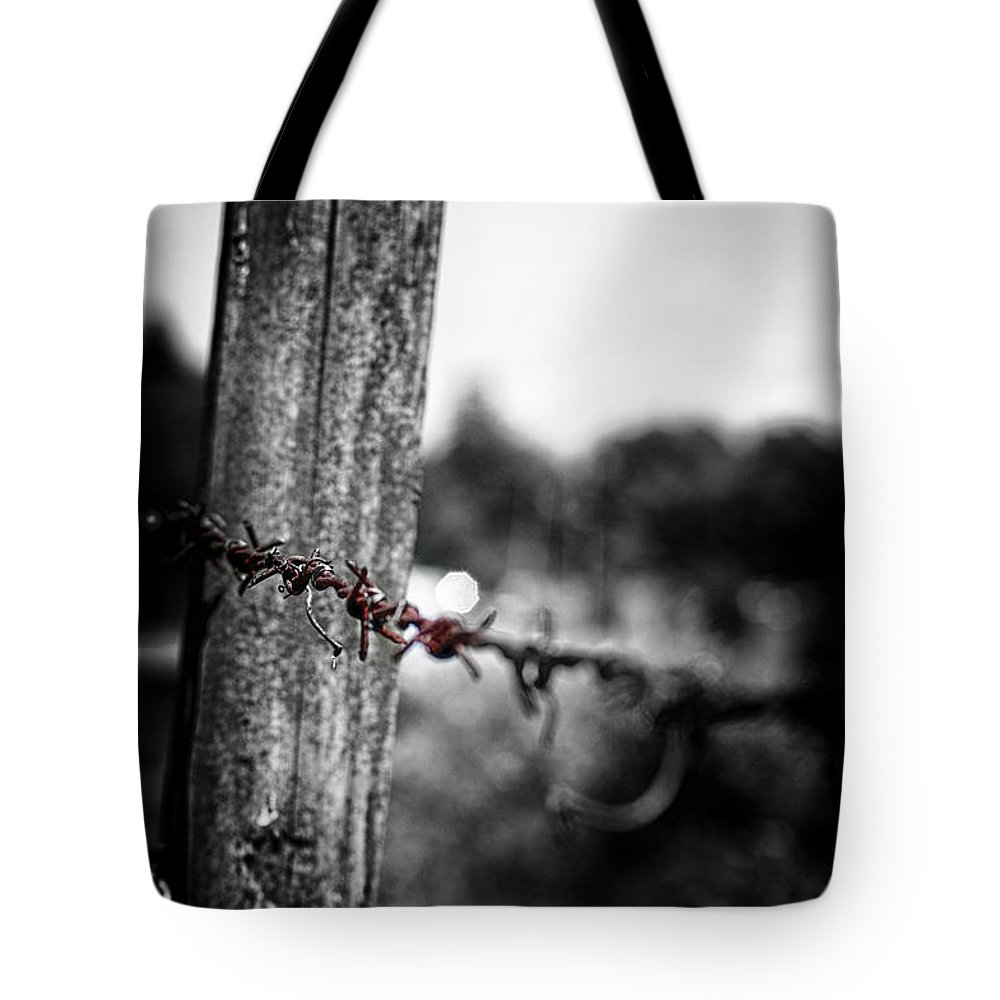 Fence Tote Bag featuring the photograph Barbed by Scott Wyatt