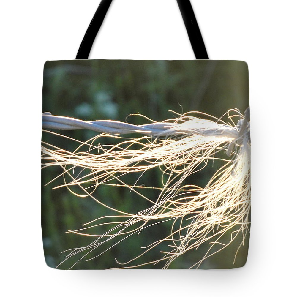 Barbed Wire Tote Bag featuring the photograph Barbed Wire by Susan Baker