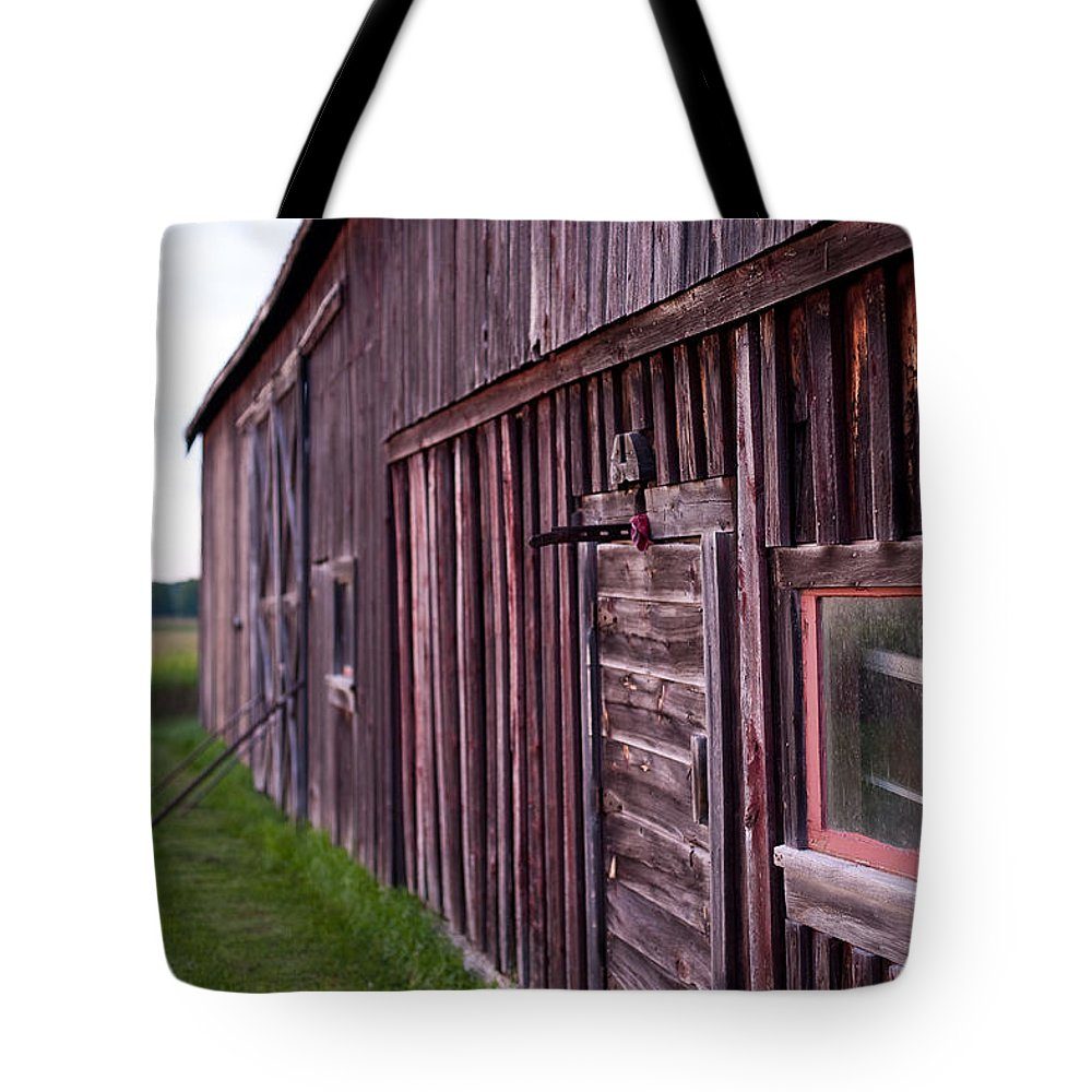 Rustic Tote Bag featuring the photograph Barn Door Small by Steven Dunn