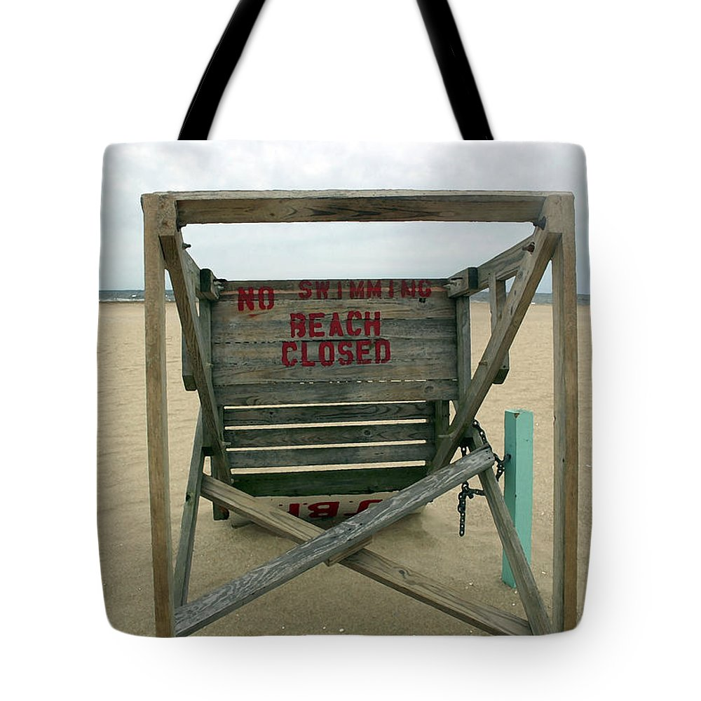 Seascape Tote Bag featuring the photograph Beach Closed by Mary Haber