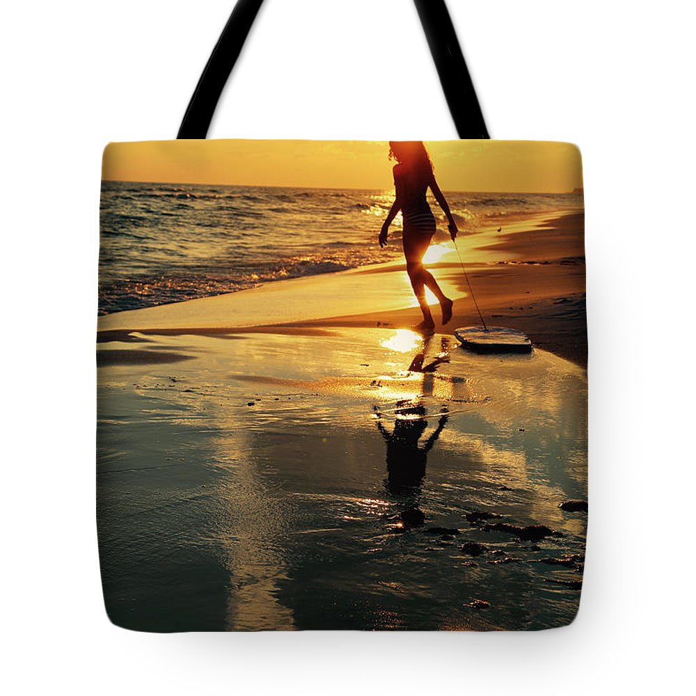 Sunset Tote Bag featuring the photograph Beach Fun 2 by Jim Clark