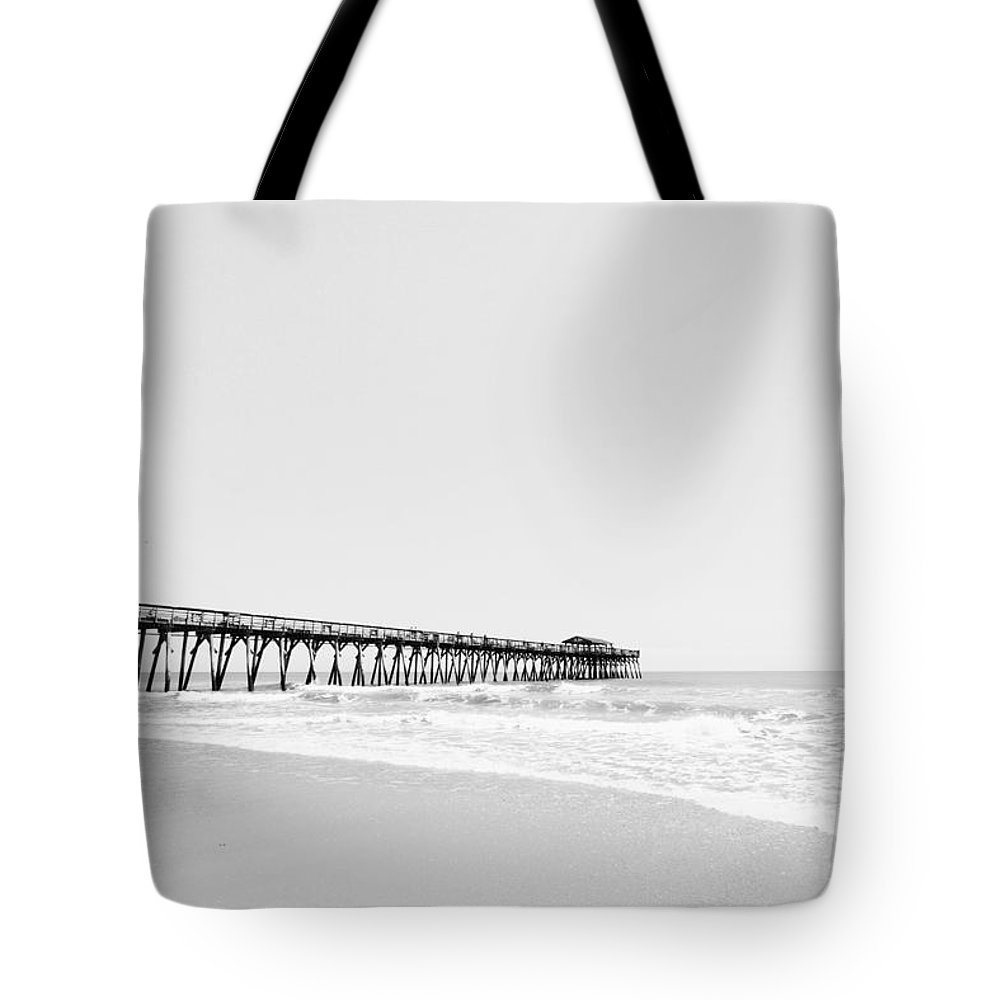 Beach Tote Bag featuring the photograph Beach Pier Minimal Black And White Photo by Stephanie McDowell