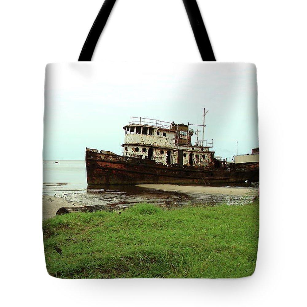 Port Gentil Tote Bag featuring the photograph Beached Ship by Brett Winn