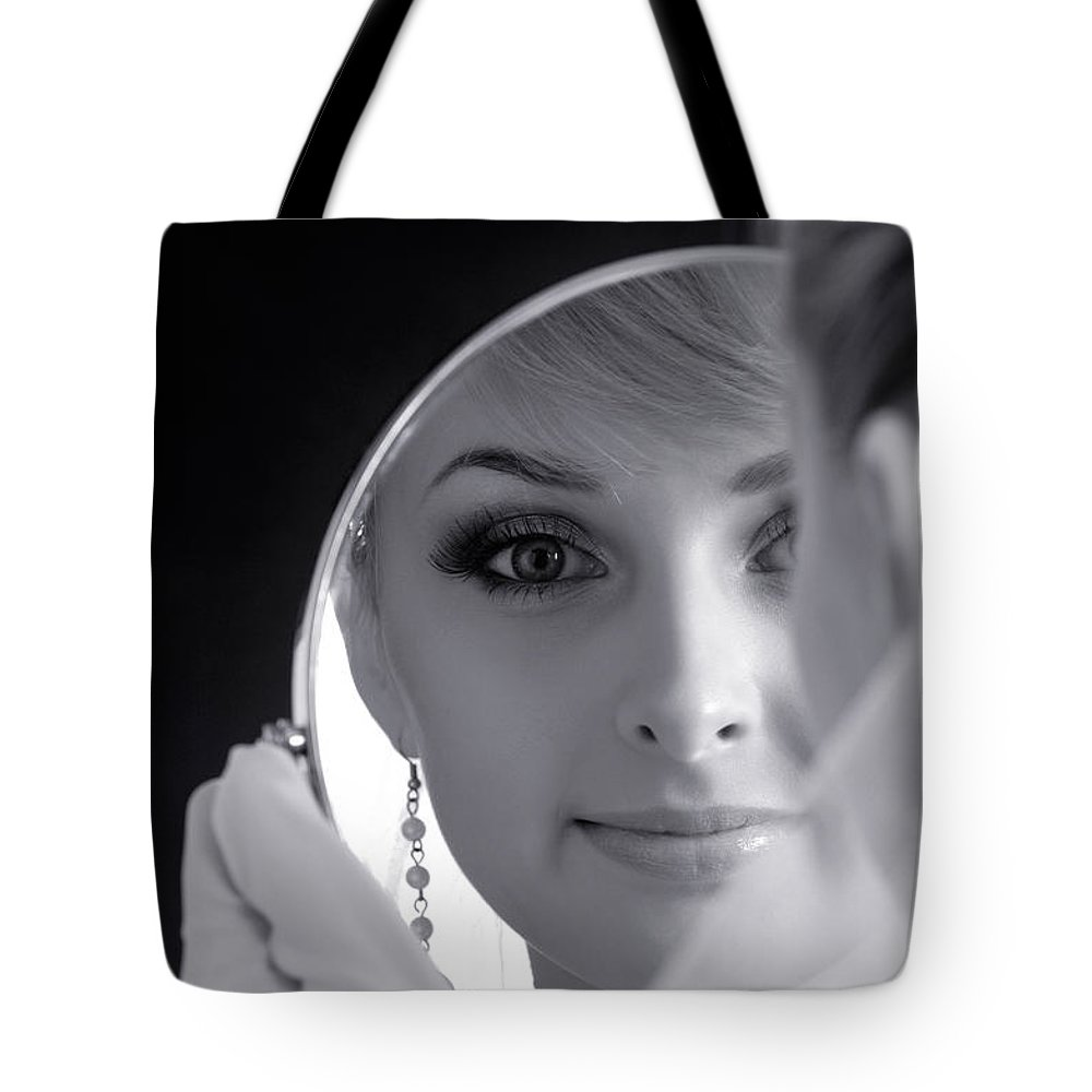 Bride Tote Bag featuring the photograph Beautiful Woman In Bridal Veil Looking At A Mirror by Oleksiy Maksymenko