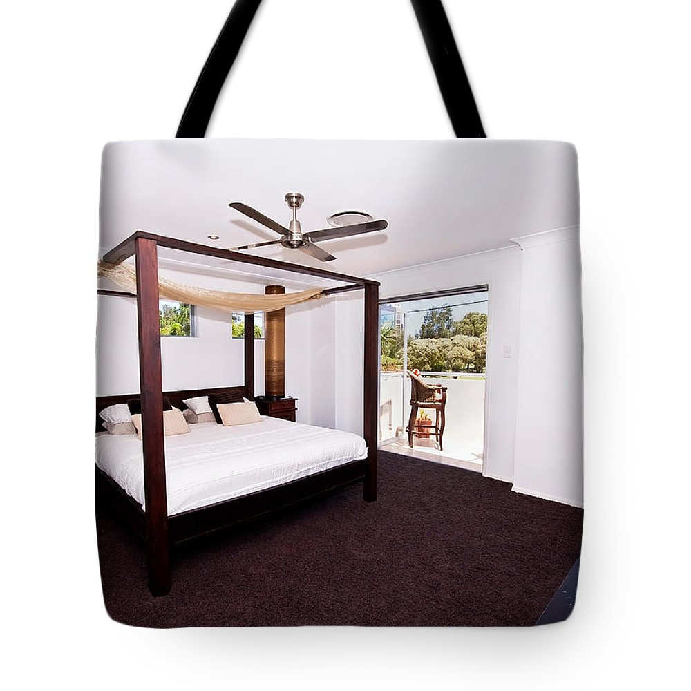 Canopy Tote Bag featuring the photograph Bed With Canopy by Darren Burton