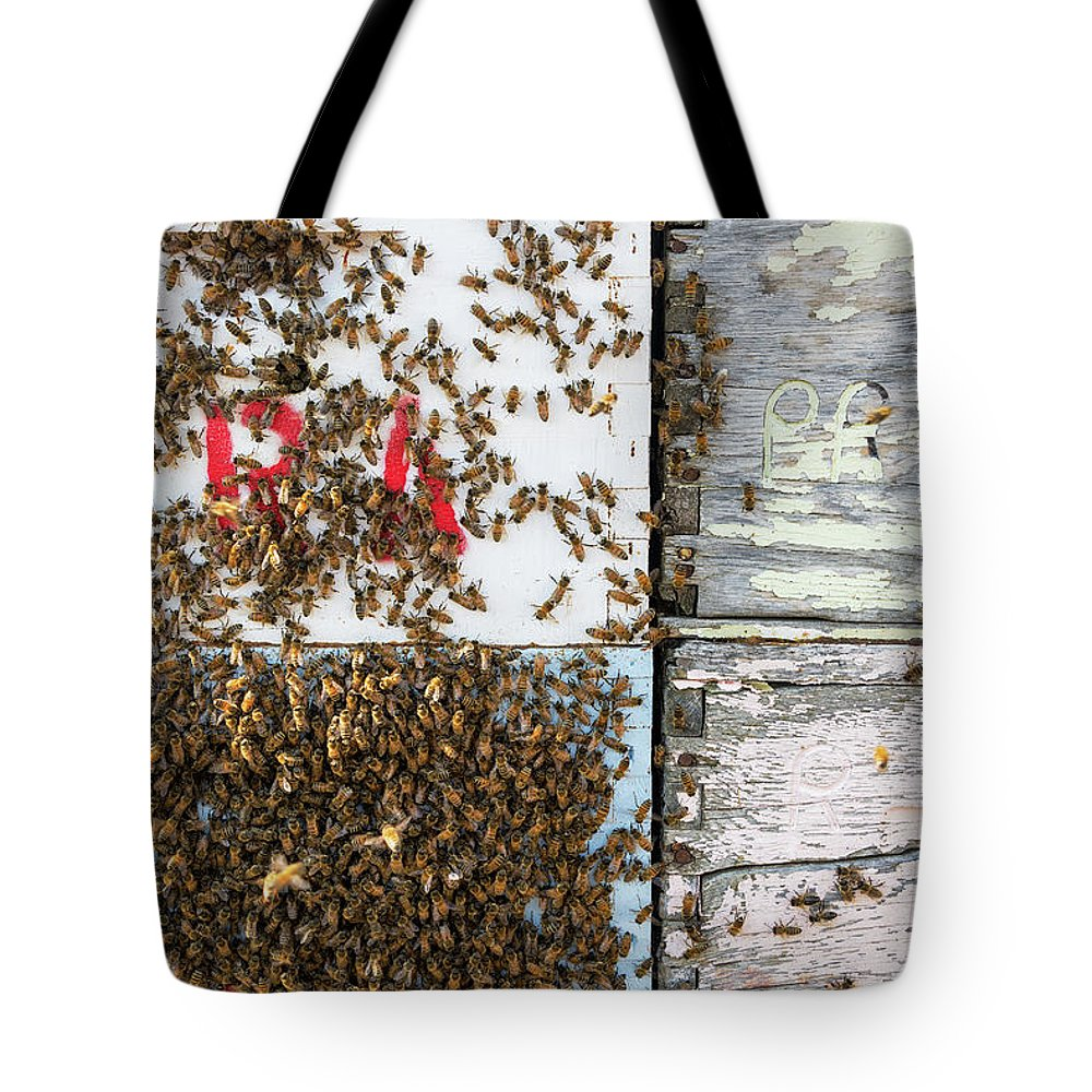 Bee Tote Bag featuring the photograph Bees on a Beehive by Jess Kraft