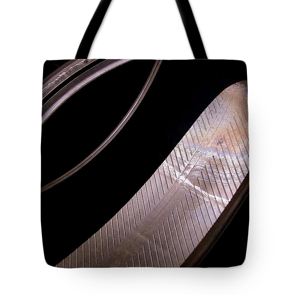 Abstract Tote Bag featuring the photograph Before The Rubber Meets The Road by Rona Black