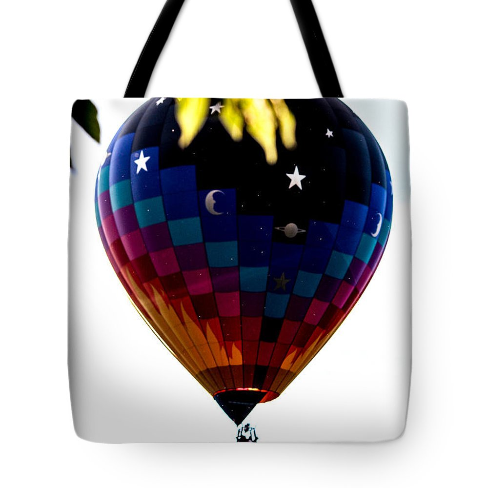 Balloon Tote Bag featuring the photograph Behind A Leaf by Victory Designs