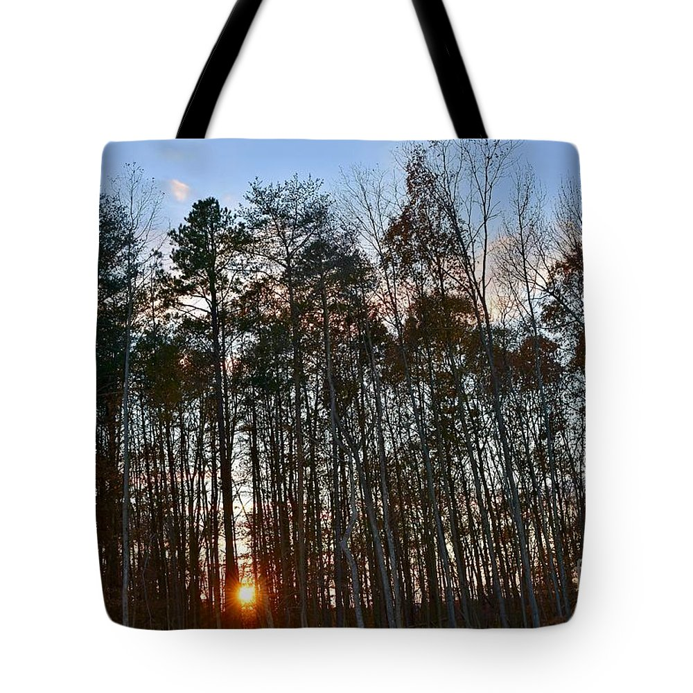 Amazing Sunset Tote Bag featuring the photograph Behind The Trees by Jeramey Lende