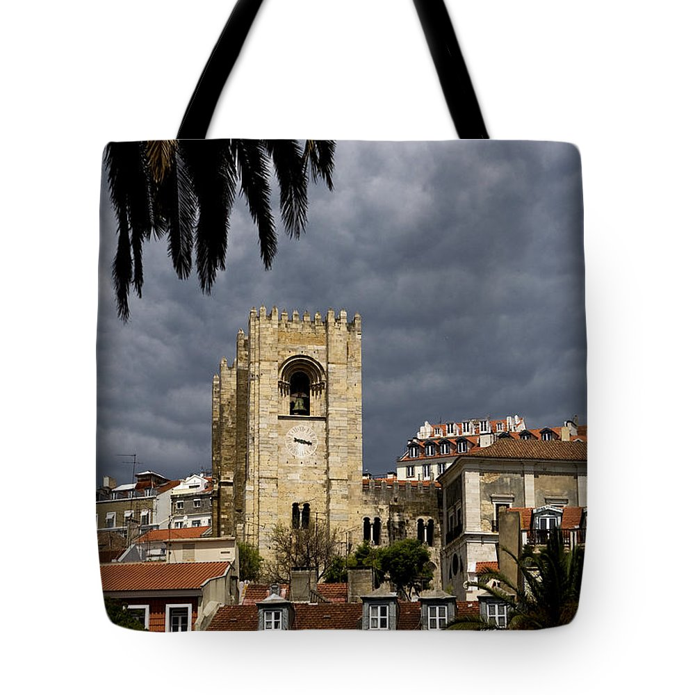 Lisbon Tote Bag featuring the photograph Bell Tower Against Roiling Sky by Lorraine Devon Wilke