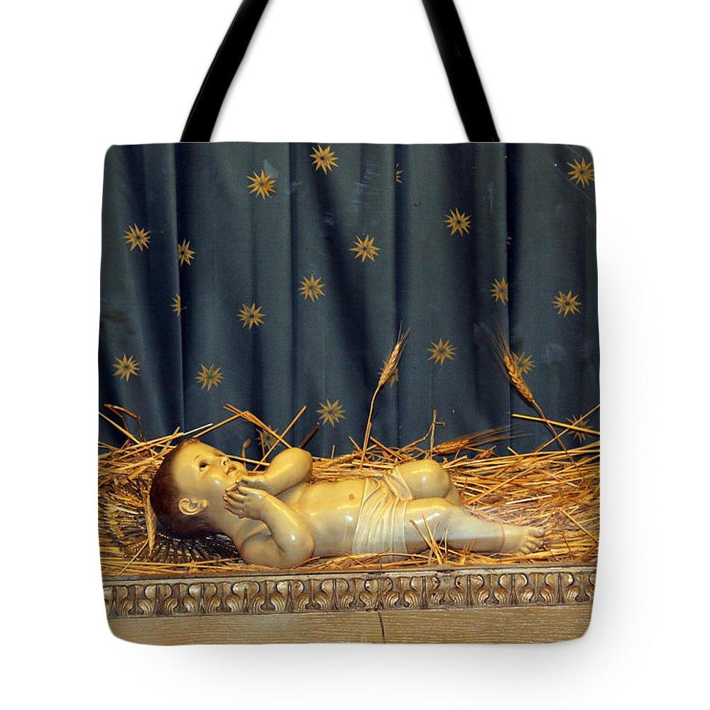 Bethlehem Tote Bag featuring the photograph bethlehem - Baby Jesus by Munir Alawi