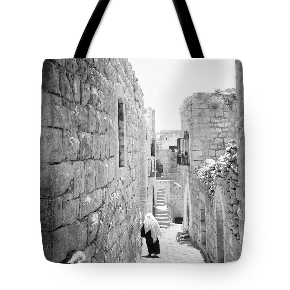 Bethlehem Tote Bag featuring the photograph Bethlehem - Old Woman Walking 1933 by Munir Alawi