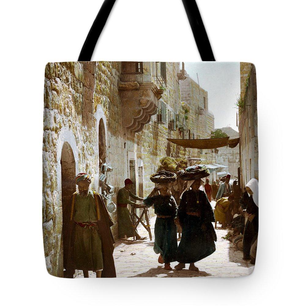 Bethlehem Tote Bag featuring the photograph Bethlehem Merchant Street by Munir Alawi
