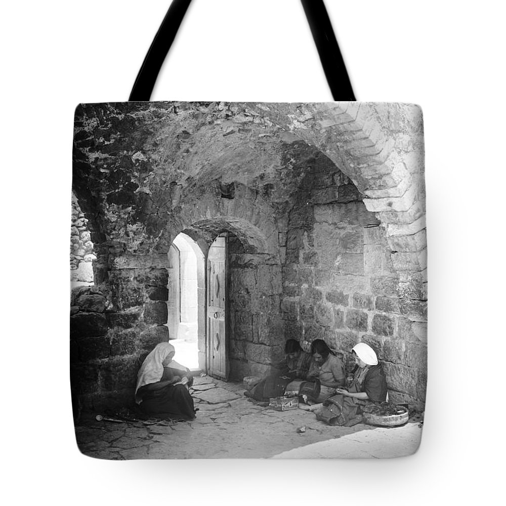 Bethlehem Tote Bag featuring the photograph Bethlehemites Women Working Year 1925 by Munir Alawi