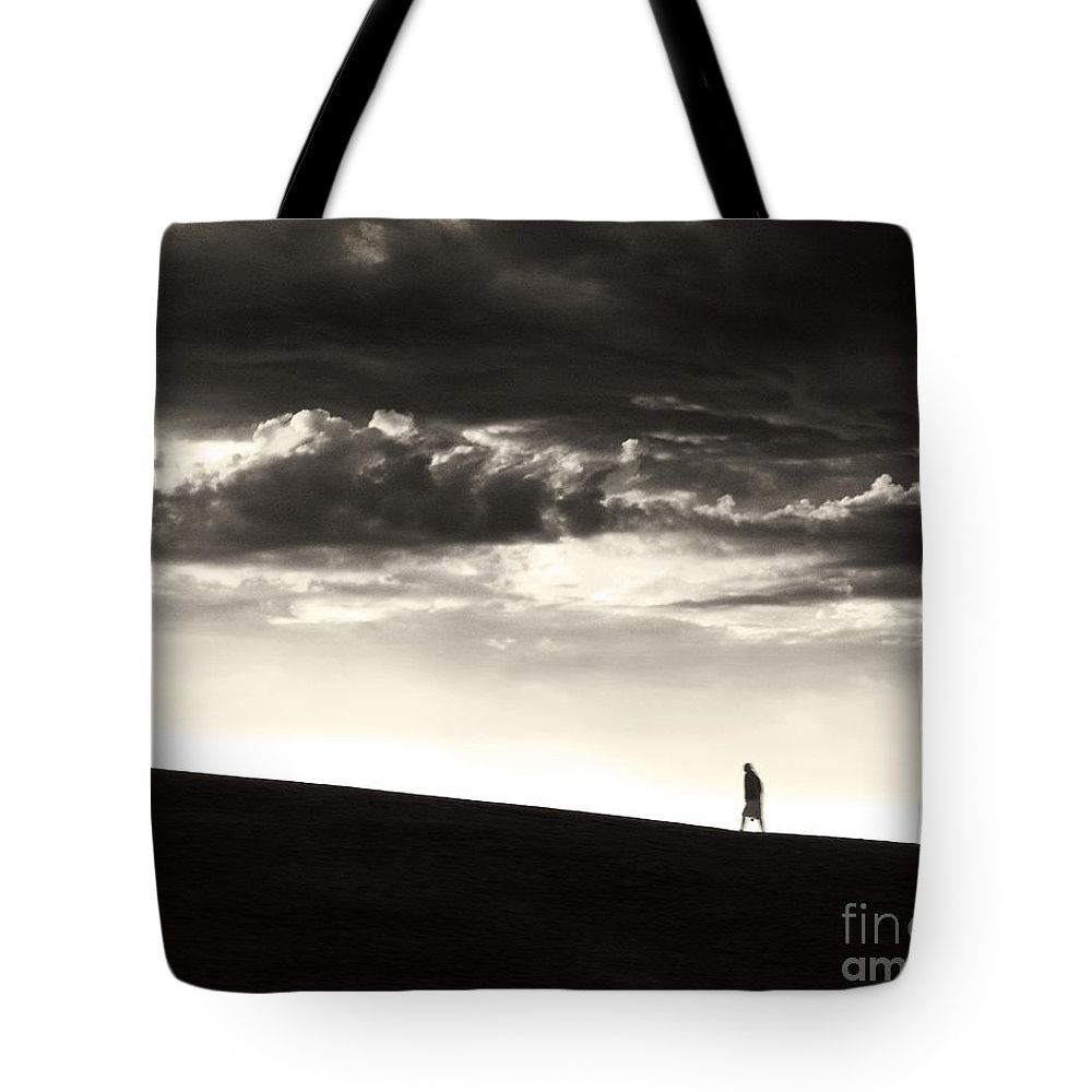 Man Tote Bag featuring the photograph Between Living And Dying by Dana DiPasquale