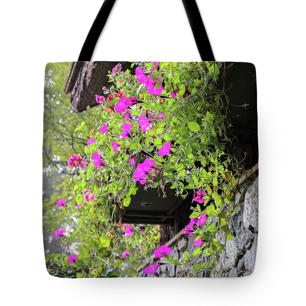 Outdoor Tote Bag featuring the photograph Beutiful Flowers Hang The Wall . by Andrew Kim