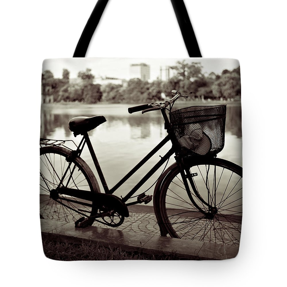 Bicycle Tote Bag featuring the photograph Bicycle By The Lake by Dave Bowman