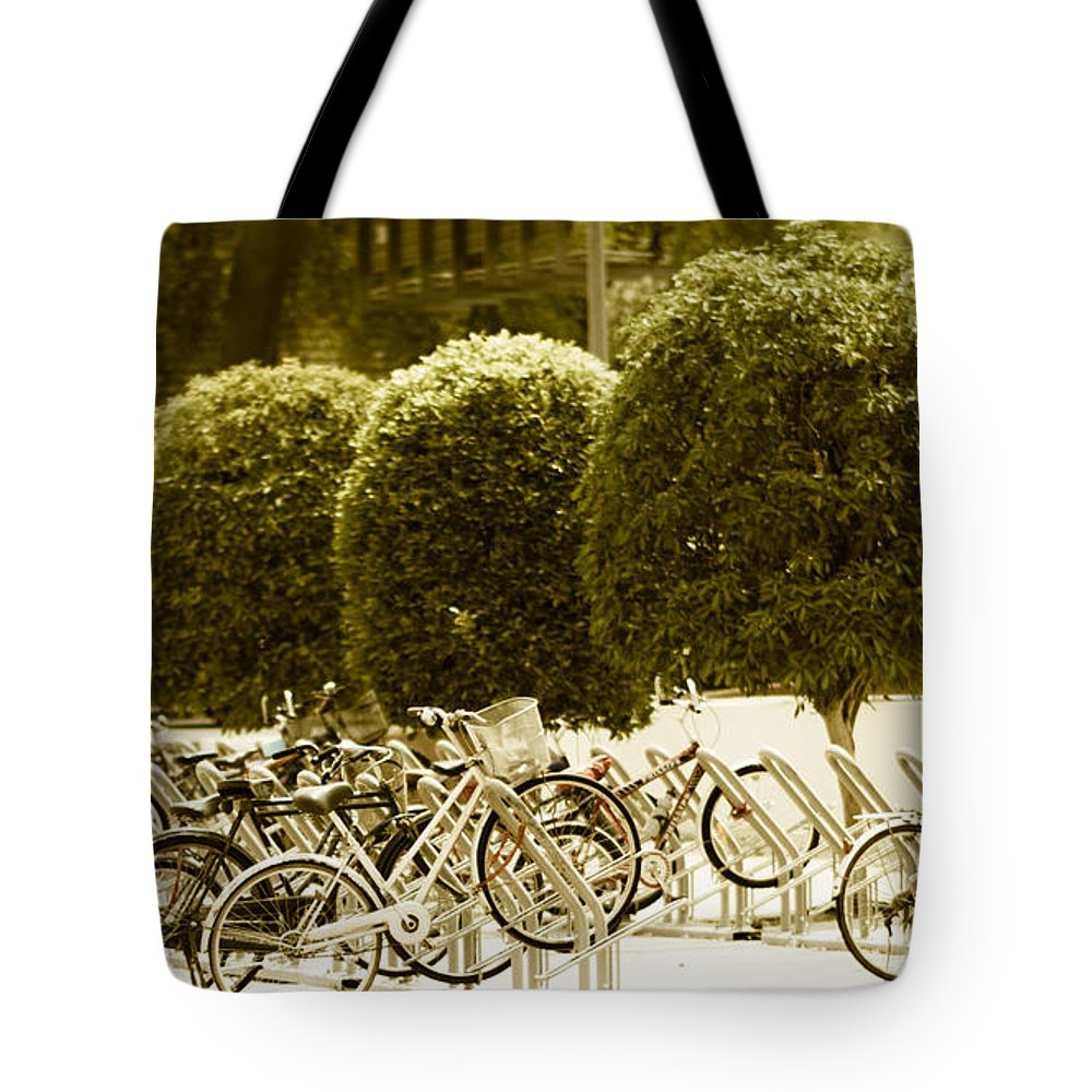 Site Pictures Tote Bag featuring the photograph Bicycle Park 2 by Emmanuel Sanni