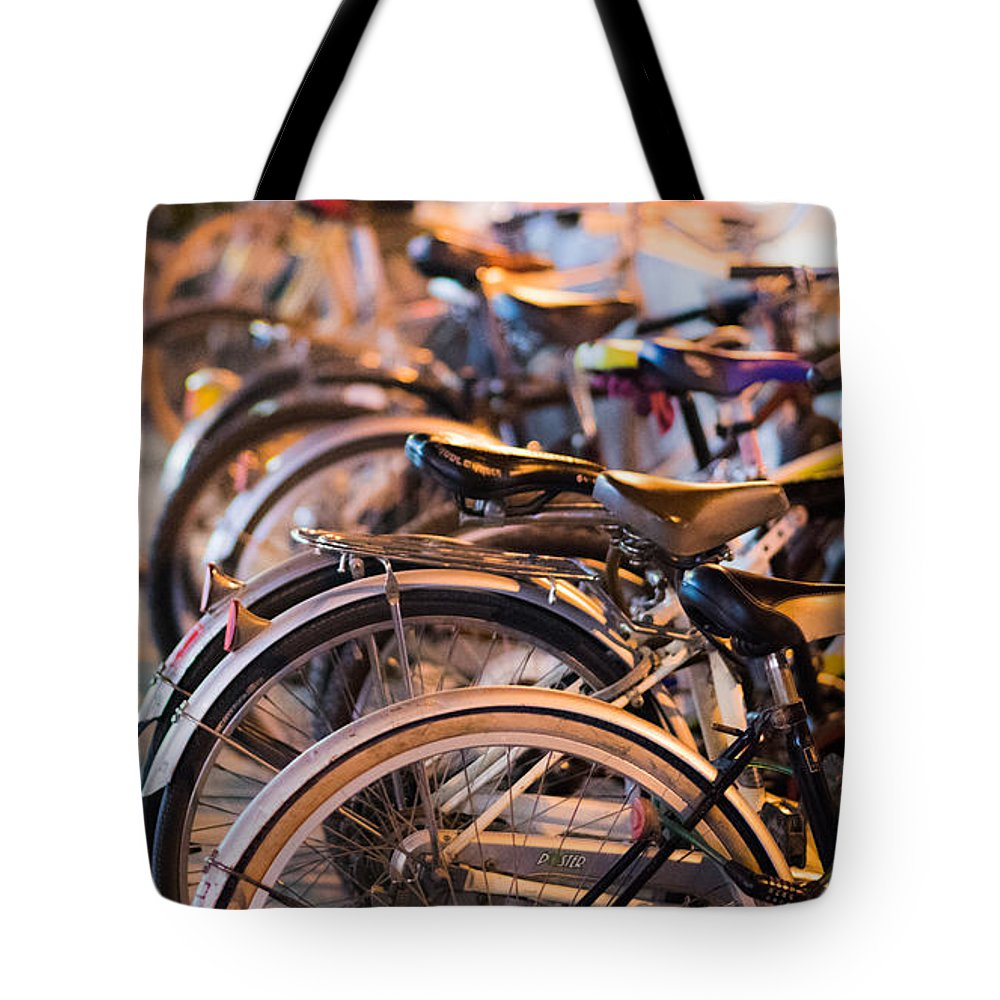 Street Tote Bag featuring the photograph Bicycle Park by Emmanuel Sanni
