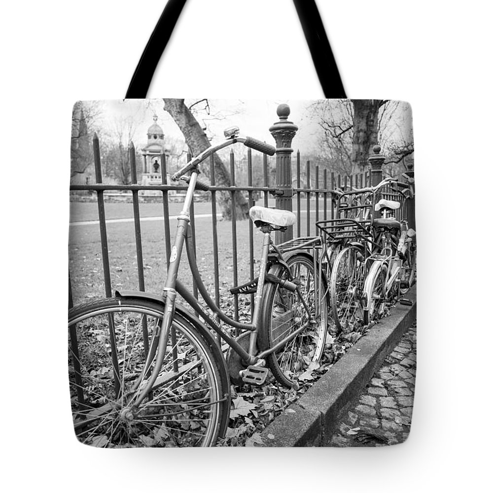 Bicycles Parked At Fence On Street Tote Bag featuring the photograph Bicycles Parked At Fence On Street, Netherlands by David Ortega Baglietto