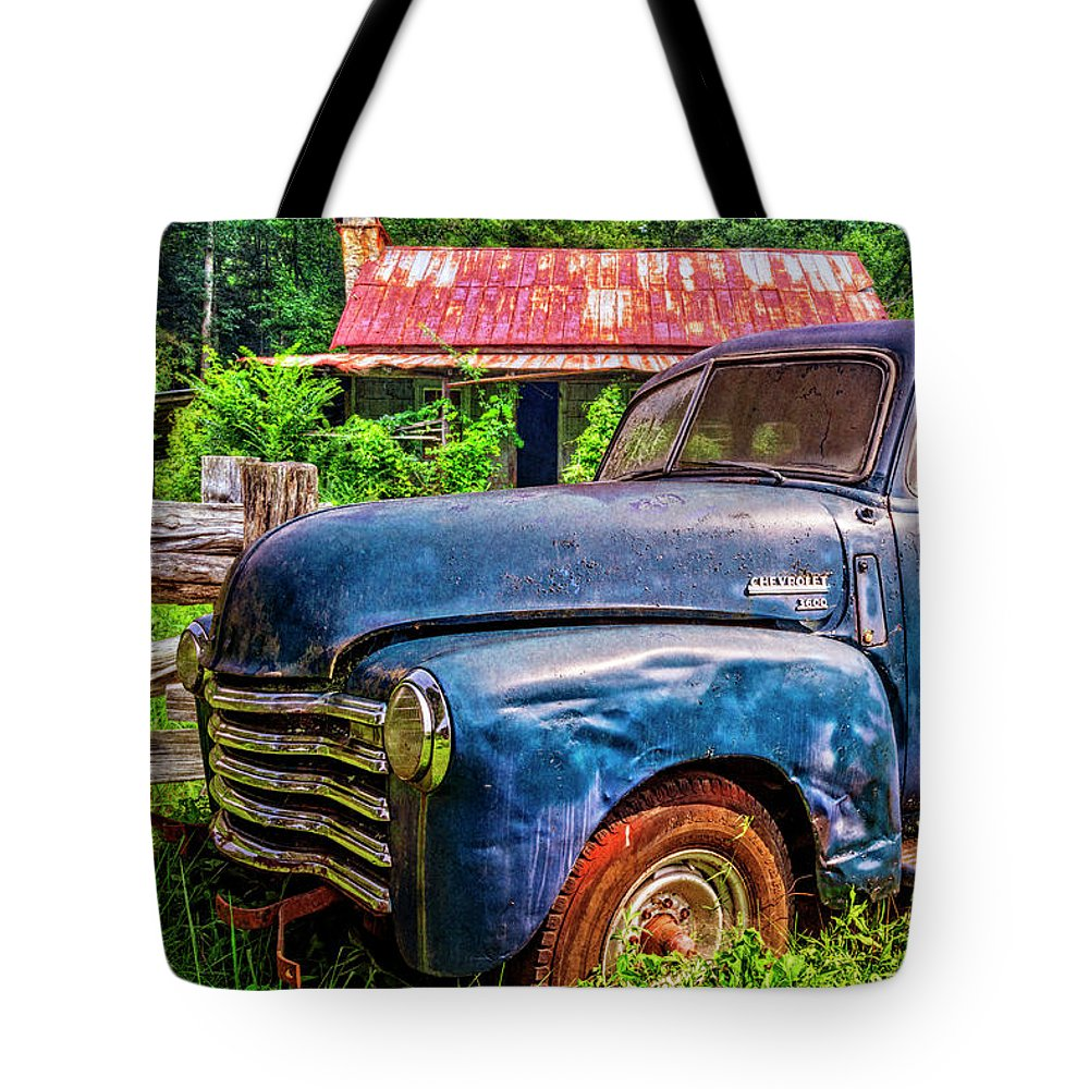 1940s Tote Bag featuring the photograph Big Blue Chevy At The Farm by Debra and Dave Vanderlaan