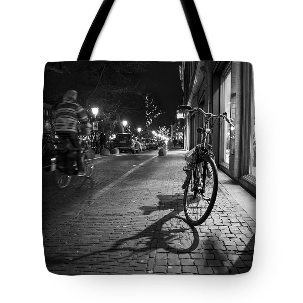 Man Riding On Bike Tote Bag featuring the photograph Bike Between Lights And Shadows, Netherlands by David Ortega Baglietto