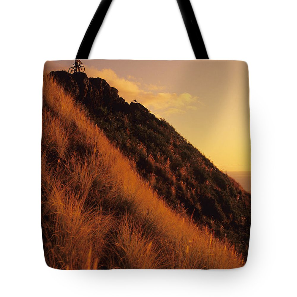 Accomplishment Tote Bag featuring the photograph Biking At Sunset by Dana Edmunds - Printscapes