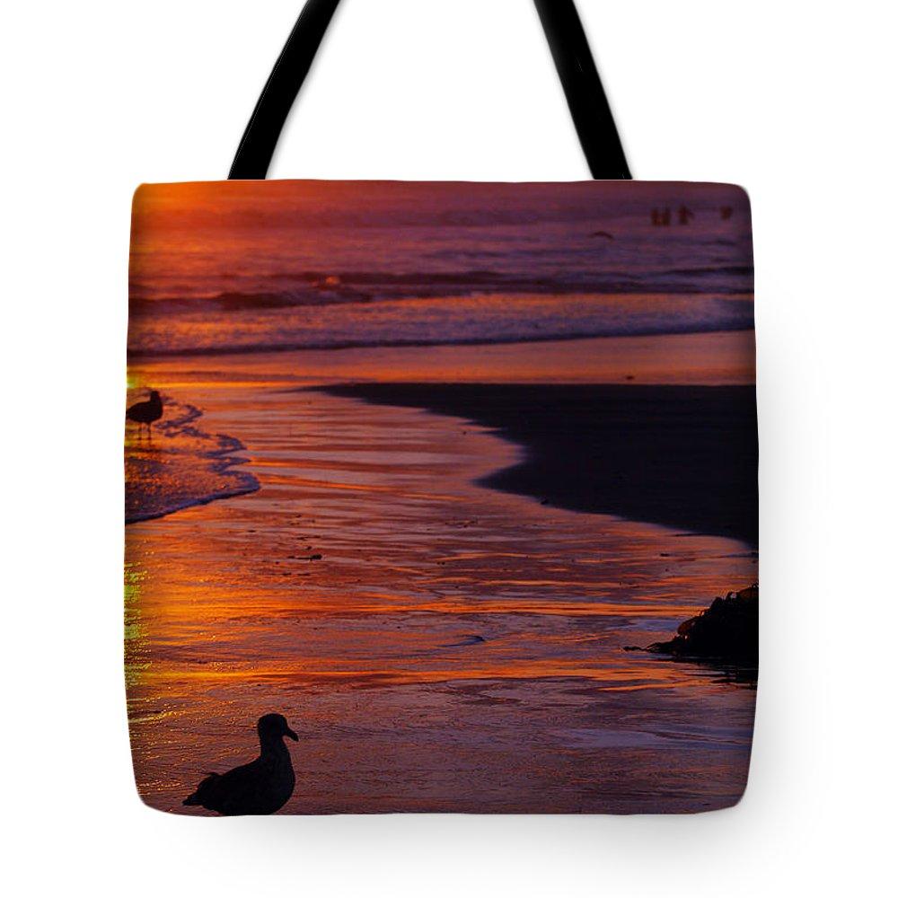 Beach Ocean Bird Sunset Orange Waves Tote Bag featuring the photograph Bird At Sunset by Jill Reger
