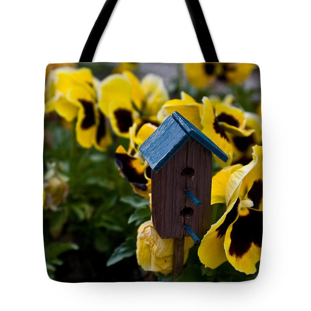 Pansy Tote Bag featuring the photograph Bird House And Pansey by Douglas Barnett