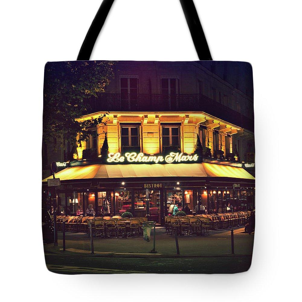Paris Tote Bag featuring the photograph Bistrot Le Champ De Mars by Marc Henderson