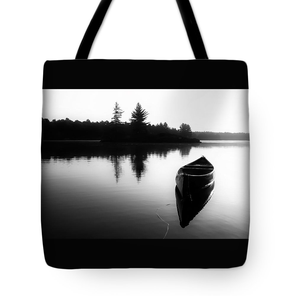 Canoe Tote Bag featuring the photograph Black And White Canoe In Still Water by Karl Anderson