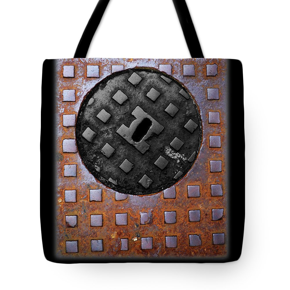 Heavy Metal Tote Bag featuring the photograph Black Diamond by Charles Stuart