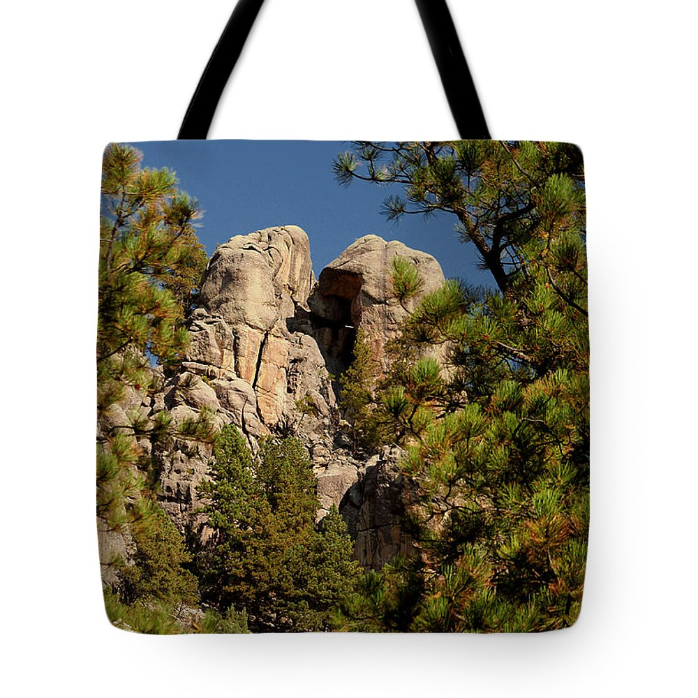 Attraction Tote Bag featuring the photograph Black Hills Rock Feature by Mike Oistad