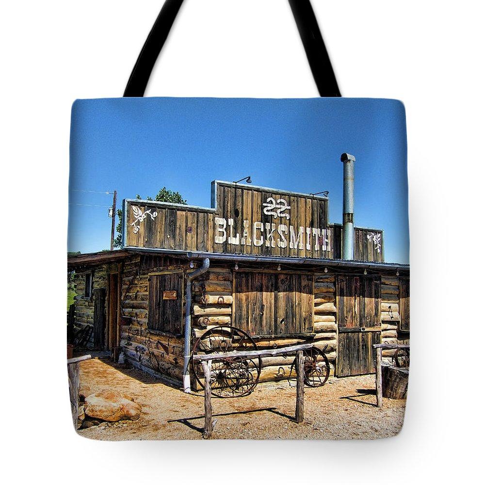 Blacksmith Tote Bag featuring the photograph Blacksmith by Douglas Barnard