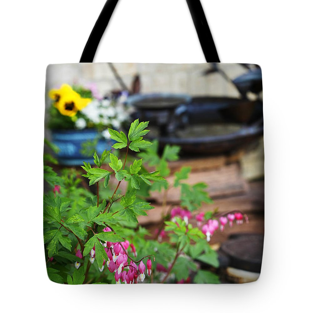 Flower Tote Bag featuring the photograph Bleeding Heart And Fountain by Marilyn Hunt