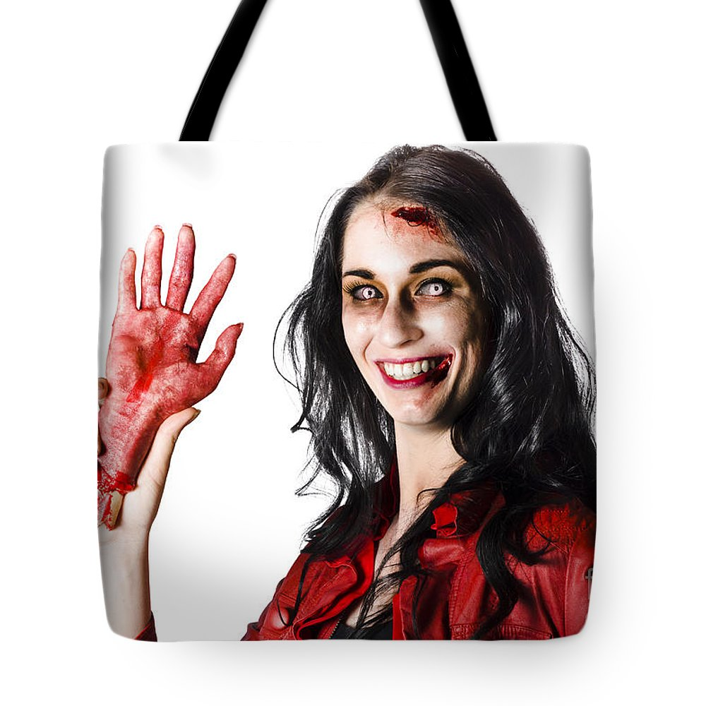 Awful Tote Bag featuring the photograph Bloody Zombie Woman With Severed Hand by Jorgo Photography - Wall Art Gallery