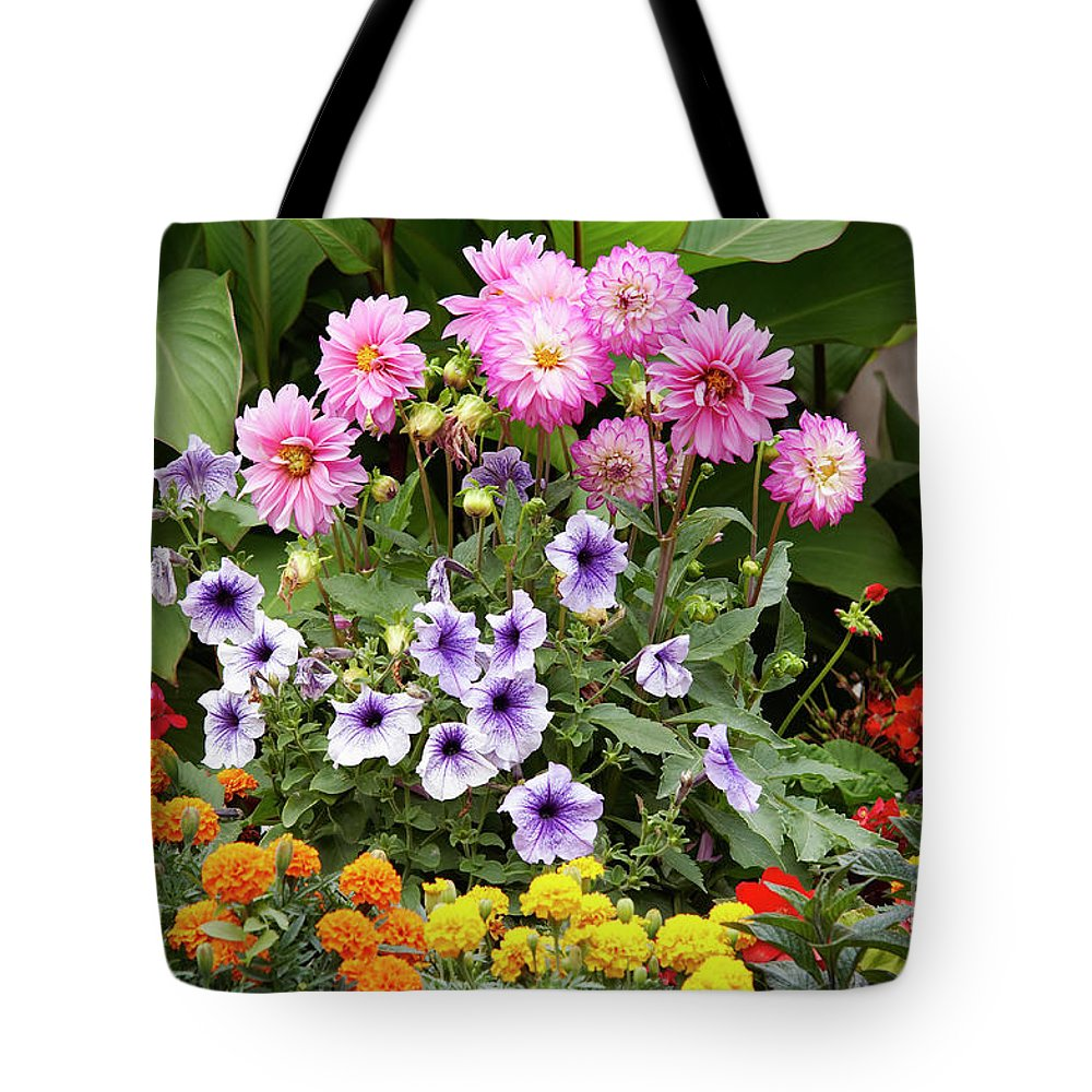 Bouquet Tote Bag featuring the photograph Blossoming Flowers by Michal Boubin