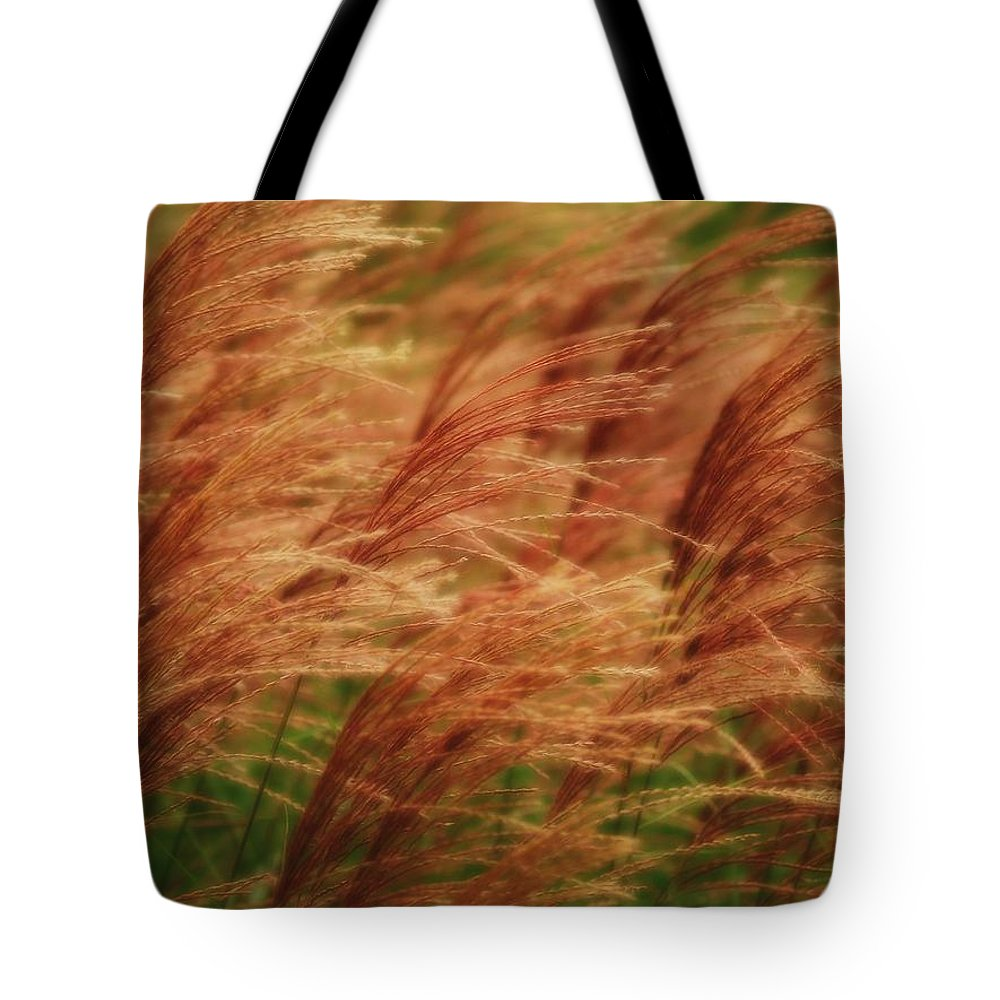 Win Tote Bag featuring the photograph Blowing In The Wind by Gaby Swanson