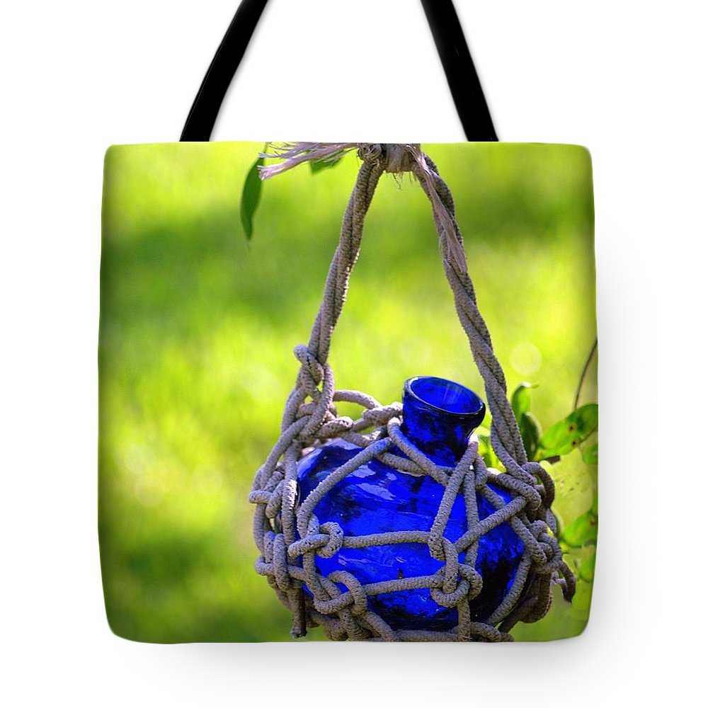 Glass Bottles Tote Bag featuring the photograph Small Blue Bottle Garden Art by Ginger Wakem