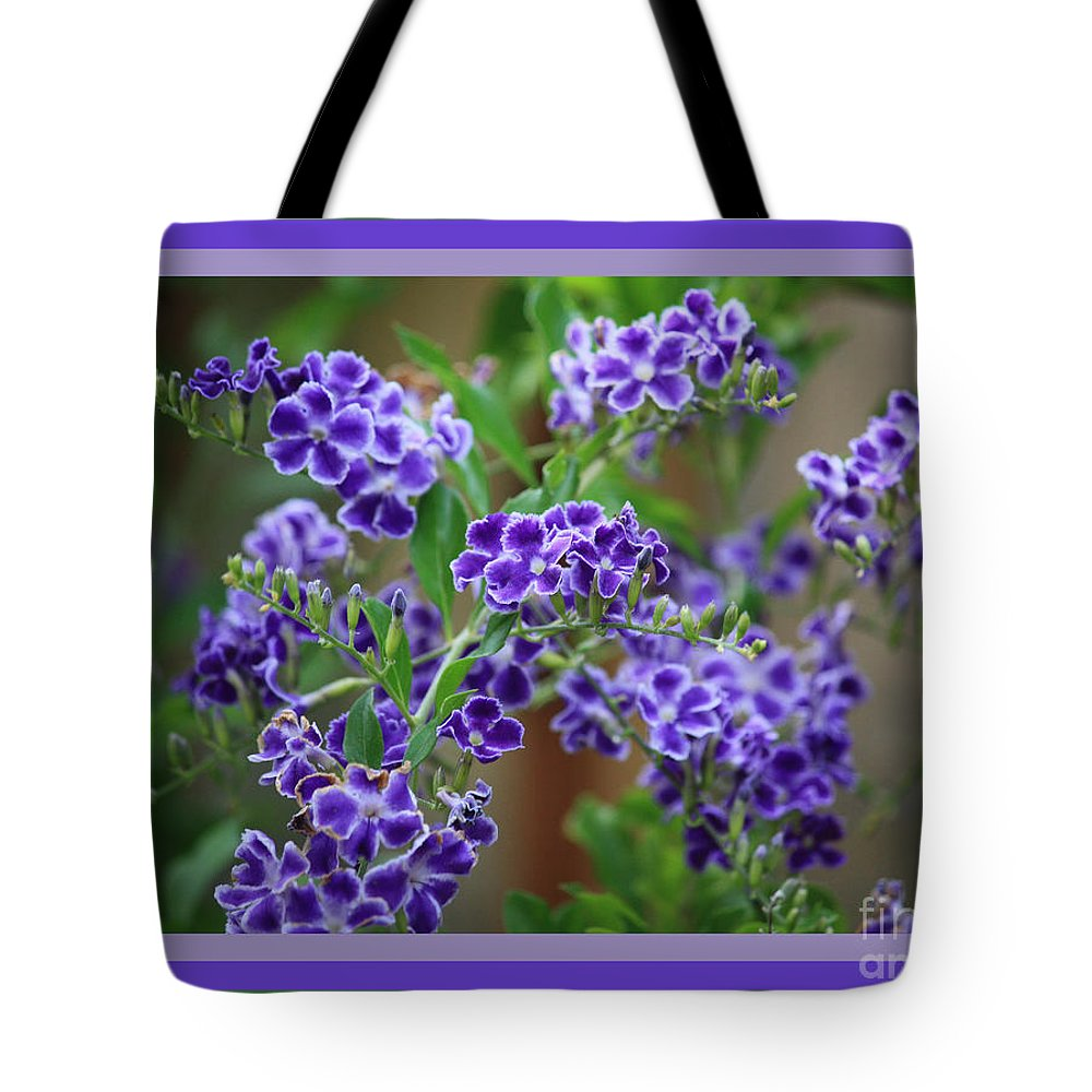 Blue Flowers Tote Bag featuring the photograph Blue Flowers With Colorful Border by Carol Groenen